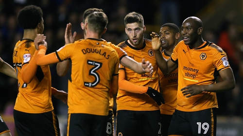 Wolverhampton Wanderers' Matt Doherty (third right) did his bit to keep his side top of the pile