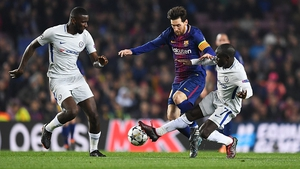Lionel Messi is challenged by N'Golo Kante and Antonio Rudiger