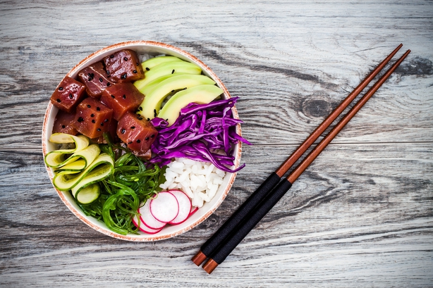 Hawaiian tuna poke bowl with seaweed, avocado, red cabbage, radishes