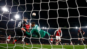 Danny Wellback heads home Arsenal's third goal