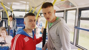 The wheels on the bus go round and round for Conor and Jock
