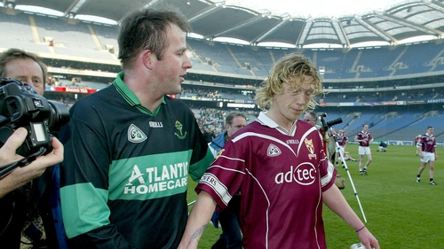 Nemo's Colin Corkery shakes hands with Ciaran McDonald of Crossmolina Deel Rovers after the 2003 All-Ireland club final