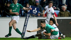 James Hume scores a try for Ireland