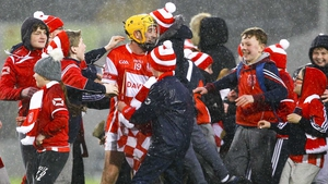 Cuala's supporters celebrate with Cian Waldron after the semi-final win against Liam Mellows