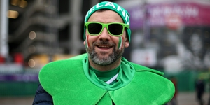An Irish fan in Twickenham gets ready for the Six Nations Championship final match as Ireland hope for a Grand Slam