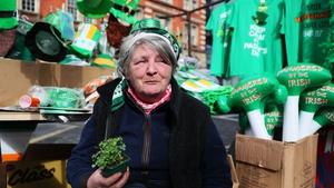 Kathleen Farrell sells St Patrick's Day merchandise on her stall on Thomas Street in Dublin