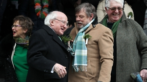 President Michael D Higgins and the St Patrick's Festival first international guest of honour, Star Wars actor Mark Hamill enjoy the Dublin parade.