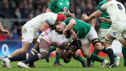 Cian Healy tackles England lock Maro Itoje