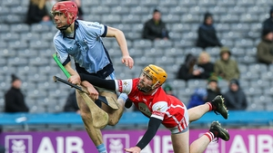 Cuala's Oisin Gough stops Adrian Breen of Na Piarsaigh