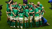 The Irish players celebrate at the final whistle at Twickenham