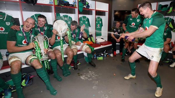 Johnny Sexton leads the celebrations in the changing room