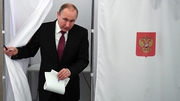 Vladimir Putin at a polling station in Moscow