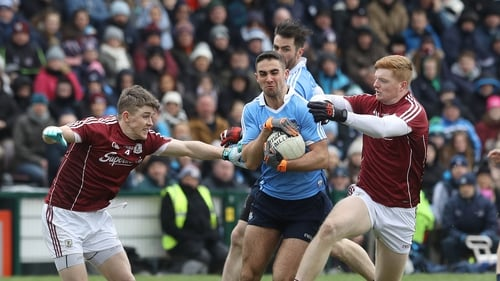 Galway's Sean Andy O'Ceallaigh and David Wynne tackle James McCarthy of Dublin