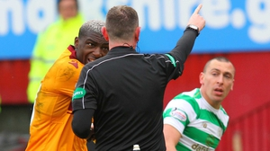 Referee Craig Thomson red-cards Cedric Kipre for pushing Scott Brown