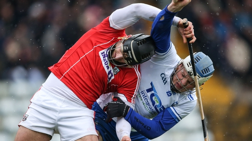 Cork's Eoin Cadogan and Waterford's Tom Devine battle for possession at Páirc Uí Rinn