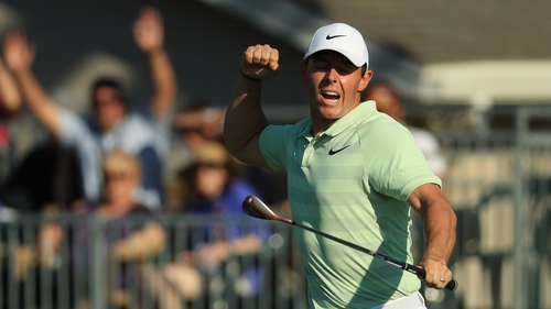 McIlroy shows his emotion after sinking a remarkable birdie on the last