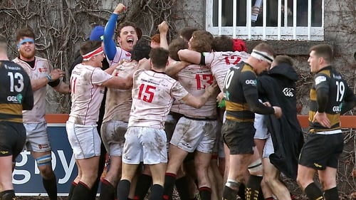 Dublin University players celebrate Tommy Whittle's late try