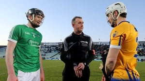 Limerick's Declan Hannon and Clare's Paul O'Connor with referee Alan Kelly at the coin toss for the free decider