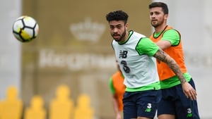 Derrick Williams, left, fends off the challenge of Shane Long in training