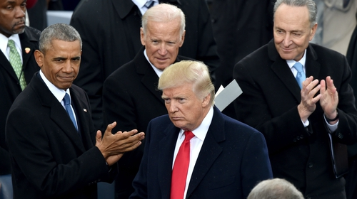 Former US vice president Joe Biden pictured standing behind US President Donald Trump at his inauguration in January 2017