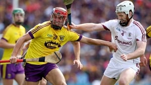 Galway's John Hanbury with Paul Morris of Wexford