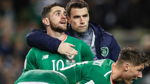 Seamus Coleman commiserates with Ireland players after the 5-1 loss to Denmark