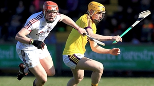 Galway's Conor Whelan with Damien Reck of Wexford
