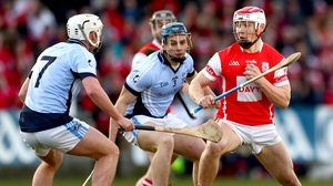 Na Piarsaigh's Kieran Kennedy and Mike Casey tackle Con O'Callaghan of Cuala