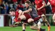 Munster's JJ Hanrahan is tackled by James Davies of the Scarlets