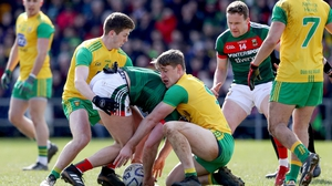 Mayo's Aidan O'Shea tangles with Hugh McFadden and Eoghan Ban Gallagher of Donegal