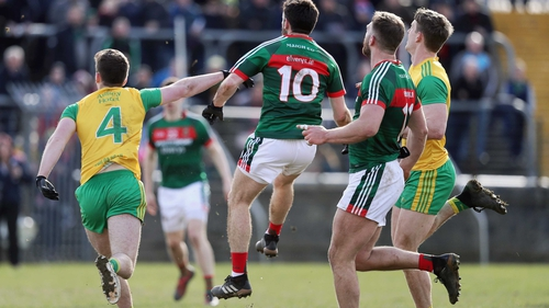 Mayo's Kevin McLoughlin scores the point to tie the game