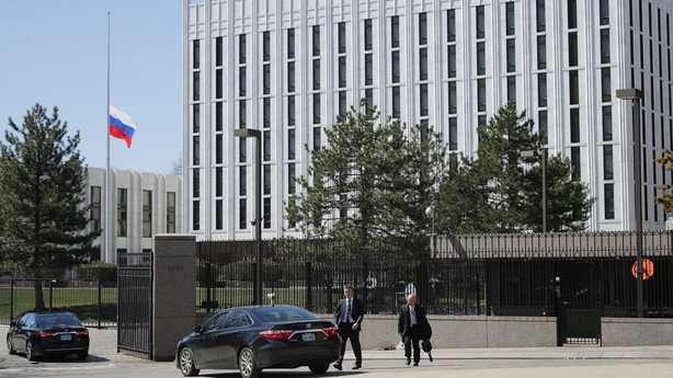 Vehicles wait to enter the Russian embassy in Washington