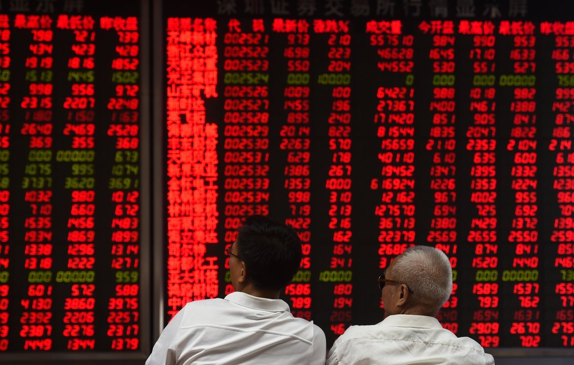 Image - Investors monitor stock price movements in Beijing