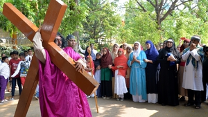 An Indian actor re-enacts the crucifixion of Jesus during a passion play in Bangalore