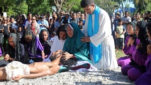 East Timorese Christian devotees re-enact the crucifixion of Jesus Christ in Dili