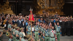 Spanish legionnaires carrying a figure of 'Cristo de la Buena Muerte' (Christ of the good death) during a procession in Malaga