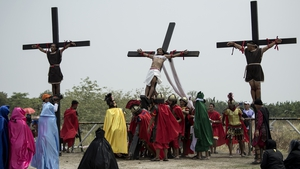 A Christian devotee is nailed to a cross during a re-enactment of the crucifixion north of Manila in the Philippines
