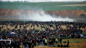 Tear gas is fired at the crowds gathered at the border