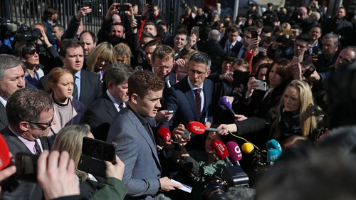 Paddy Jackson speaks to media and members of the public outside the courthouse