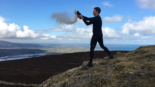Stan Zamyatin Moore scattering Thom Moore's ashes this afternoon atop Knocknarea, Co Sligo