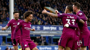 Manchester City's Leroy Sane (L) celebrates scoring his side's first goal of the game with his team-mates