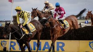 Al Boum Photo, under David Mullins in the yellow and black, on his way to winning The Ryanair Gold Cup