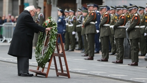 President Michael D Higgins lays a wreath outside the GPO