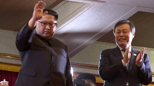Kim Jong-un (L) and South Korea's Culture Minister Do Jong-hwan during a performance of the South Korea's art troupe in Pyongyang yesterday