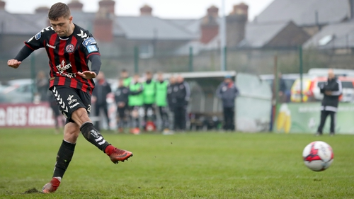 Eoghan Stokes scores the decisive penalty