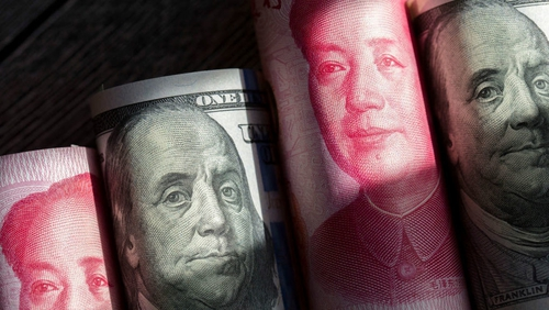 China allowed the yuan to fall below seven to the dollar for the first time in about a decade yesterday