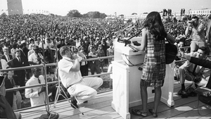 Joan Baez performing at the Civil Rights March on Washington in 1963. Photo: Getty Images