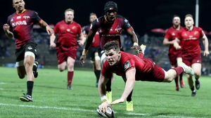 Calvin Nash goes over for a Munster try