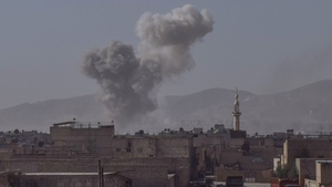 Smoke rises after air strikes at Douma town, Eastern Ghouta