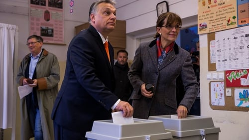 Viktor Orban casting his vote with his wife Aniko Levai this morning